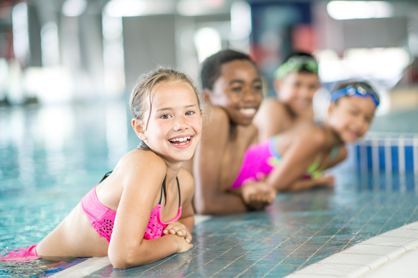 Group of children in swimming lessons