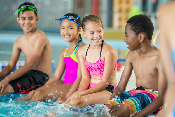 Group of children at swimming lessons