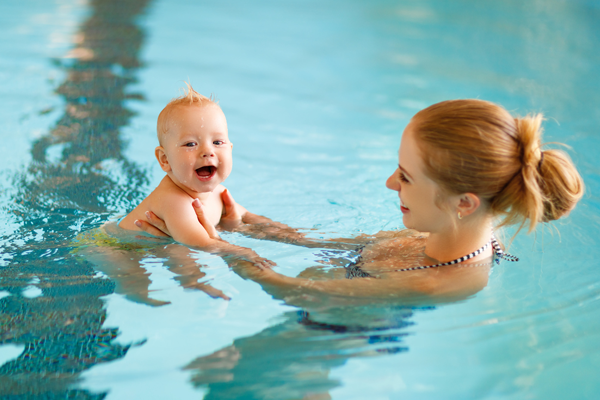 Mother and child in swimming pool