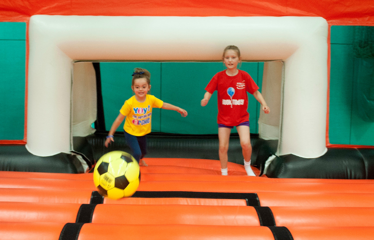 Children playing on inflatable